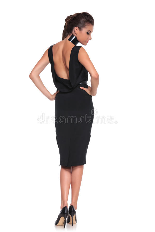 Woman in a black dress with naked back stock photography