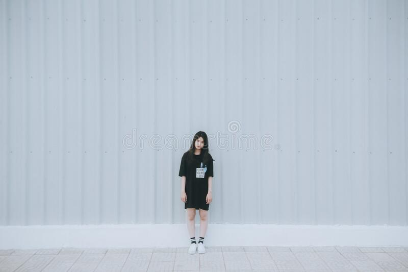 Woman In Black Elbow Sleeve Shirt And Black Shorts Standing Behind White Wall Free Public Domain Cc0 Image
