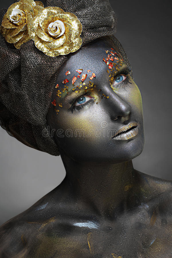 Woman with black face. Art photo of a beautiful woman with black face. Art face art fantasy make up stock photography