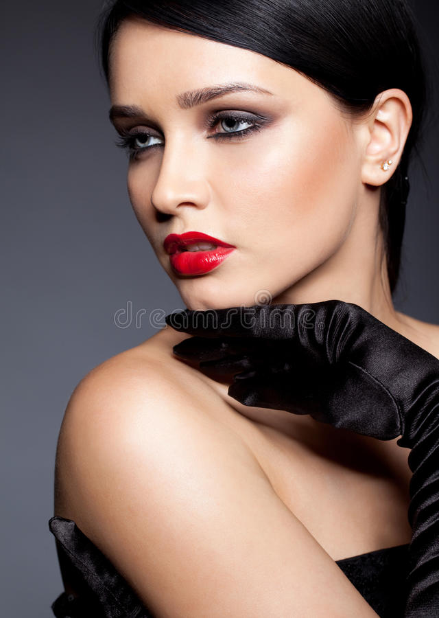Woman with black gloves stock photography