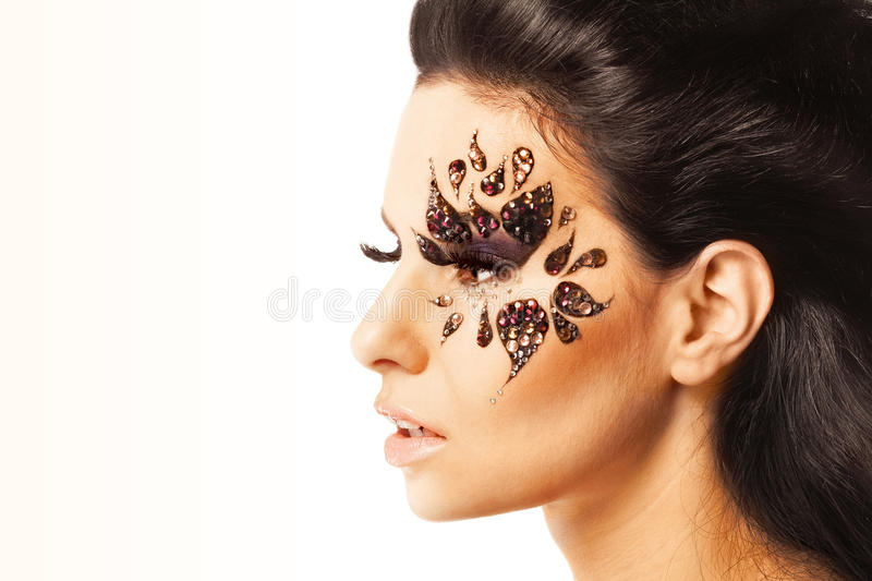 Woman with black hair and art make up stock photography