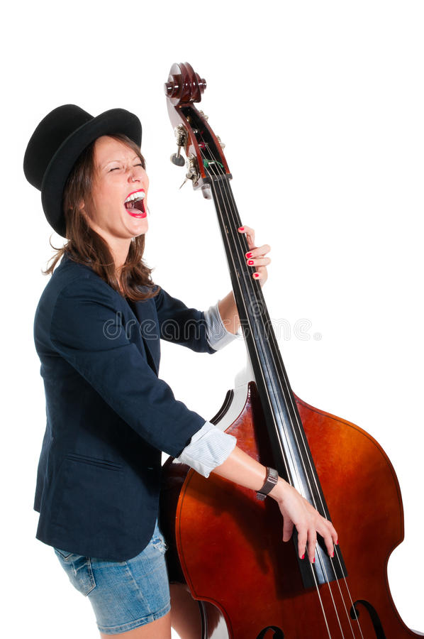 Woman in black hat play double bass. Isolated on white stock images
