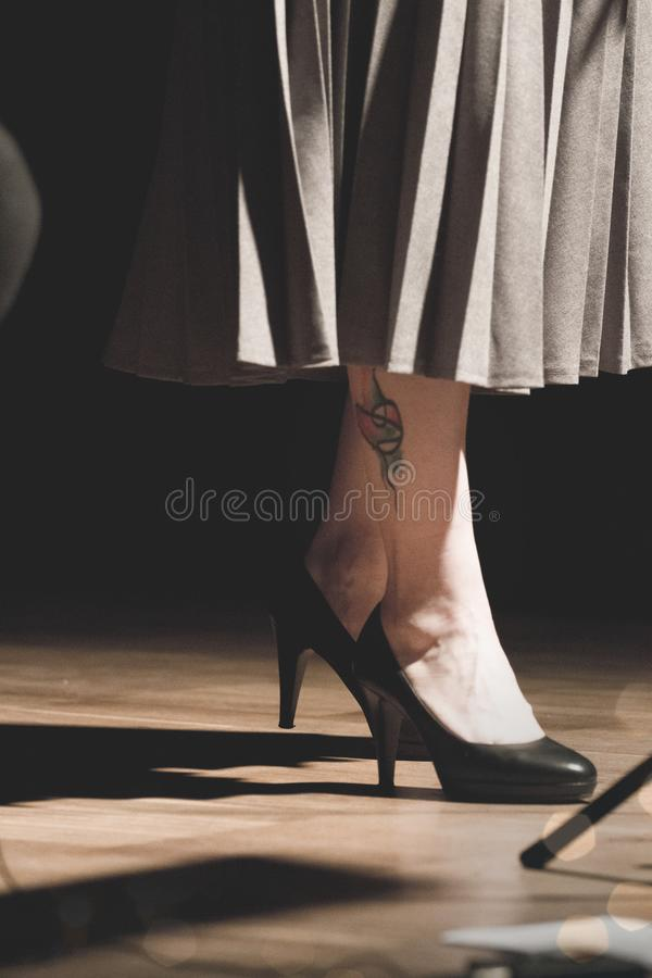 Woman in Black Heeled Shoes Standing on Brown Surface royalty free stock photos
