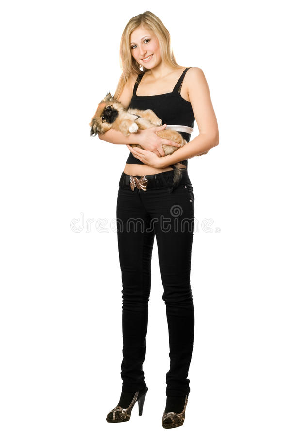Woman in black holding puppy stock photos