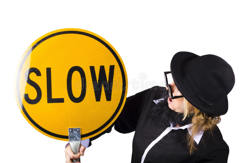 Woman In Black Holding Yellow Slow Sign Royalty Free Stock Photography