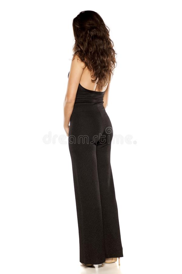 Woman in black jumpsuit stock photo