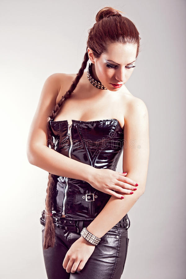 Woman in black leather outfit