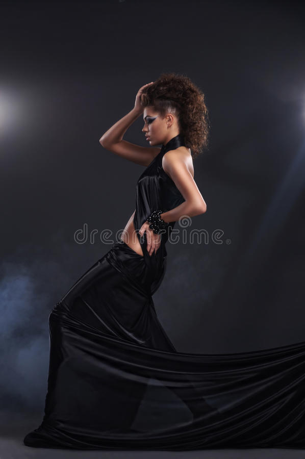 Download Woman In Black Long Dress Over Dark Background Stock Image - Image: 22251163