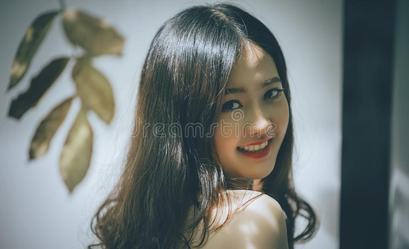 Woman with Black Long Hair Smiling stock image