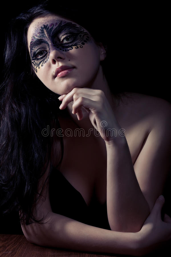 Woman in black mask. Young woman in black mask stock photos