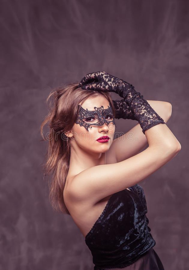Woman in Black Mask stock photos