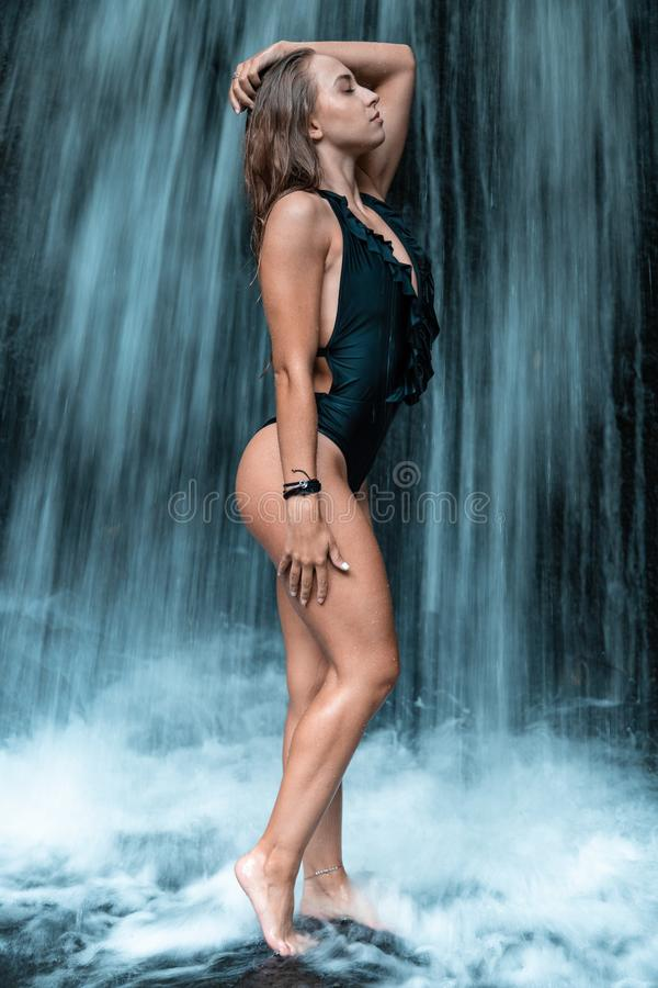 Woman In Black One Piece Standing In Front Of Waterfall Free Public Domain Cc0 Image