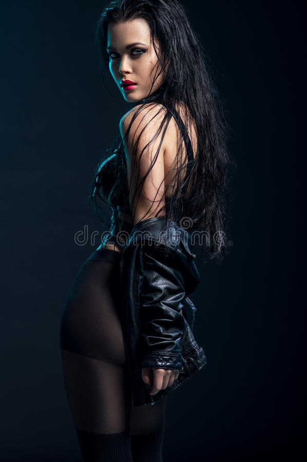 Woman in black outfit in studio royalty free stock photos