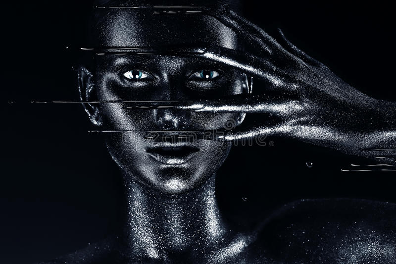 Woman with black paint on fingers royalty free stock photo