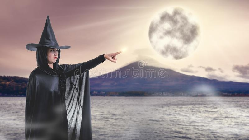 Woman in Black Scary witch halloween costume with Mount Fuji and royalty free stock photos