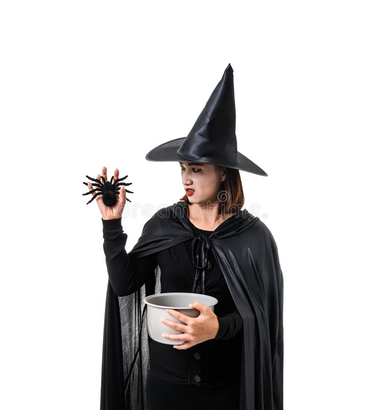 Portrait of woman in black Scary witch halloween costume standing with hat isolated on white background. Woman in black Scary witch halloween costume standing stock photography