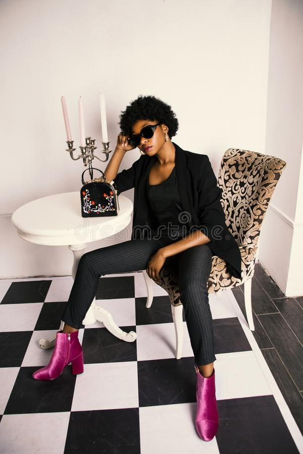 Woman in Black Shirt and Blazer Sitting on White and Brown Wooden Chair stock images