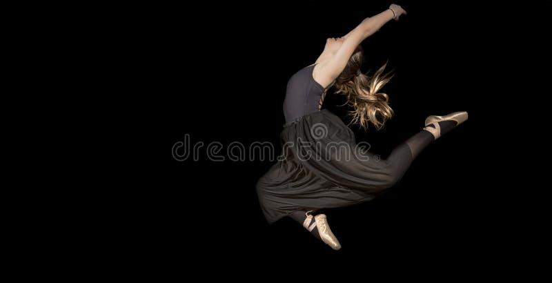 Woman in Black Sleeveless Shirt and Pants Jumping stock photos