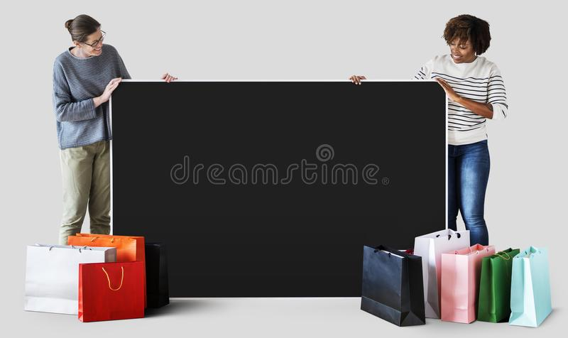 Woman with a black space and shopping bags stock images