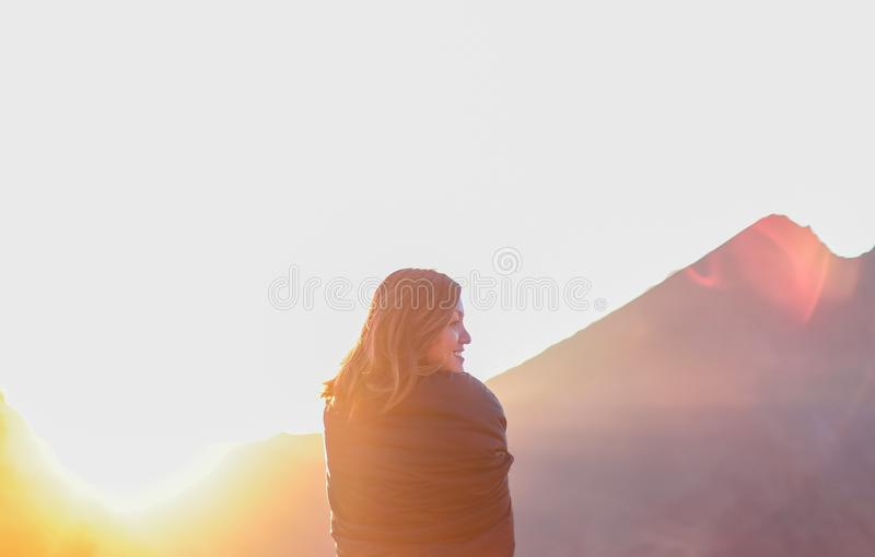 Woman In Black Standing Under White Clouds With Distant Mountain At Sunrise Free Public Domain Cc0 Image