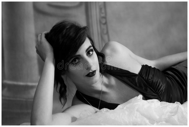 Woman in Black Top Lying on Bed royalty free stock images