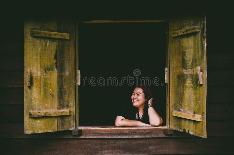 Woman in Black Top Sitting in Front of Opened 2-door Panel Window stock photos