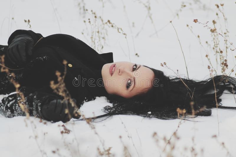 Woman In Black Trenchcoat Laying On White Snow Free Public Domain Cc0 Image