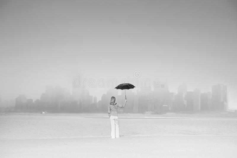 Woman with black umbrella view great metropolis royalty free stock photography