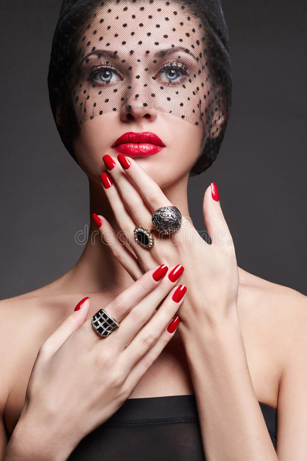 Woman with black veil and jewelry royalty free stock images