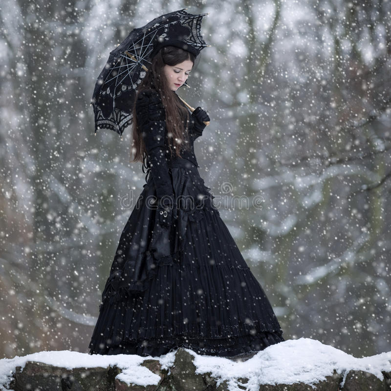 Woman in black Victorian dress stock image