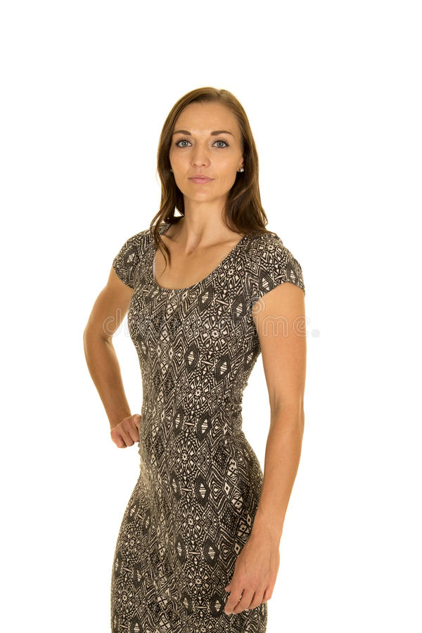 Woman in black and white dress hand on hip serious royalty free stock photo
