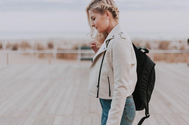 Woman in Black Zip-up Jacket With Black Backpack stock images