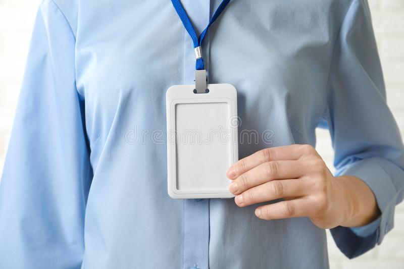 Woman with blank badge, closeup royalty free stock image