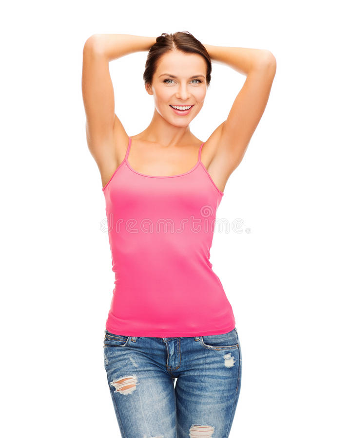 Woman in blank pink tank top. Tank top design concept - smiling woman in blank pink tank top stock photography
