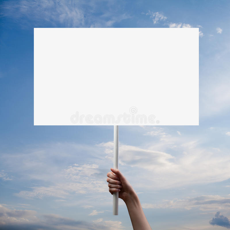 Woman with blank poster. Over sky stock photo