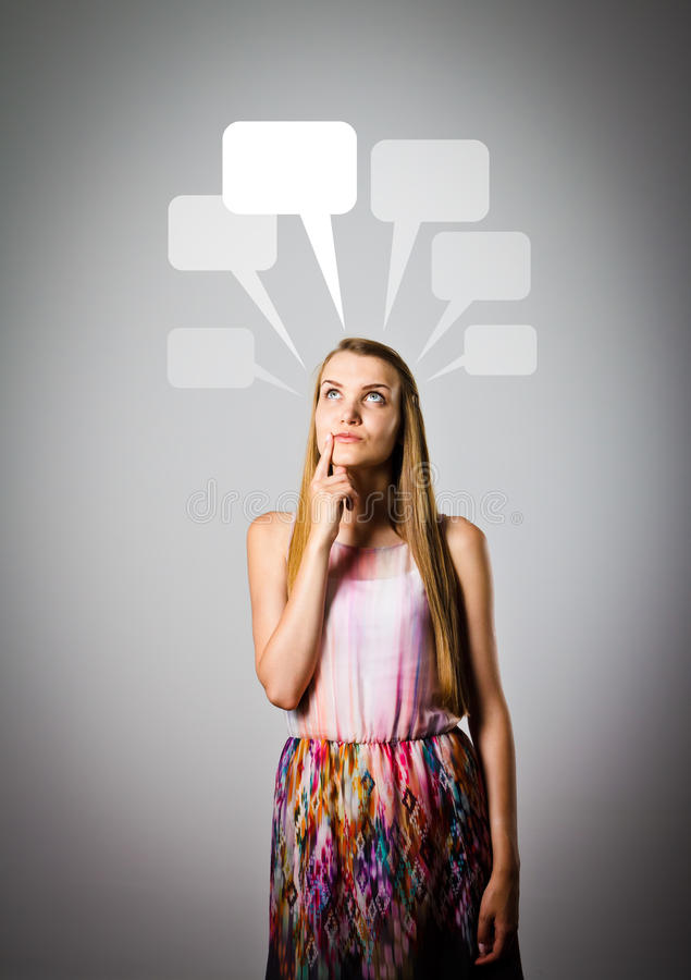 Girl and blank speech bubbles. stock photography