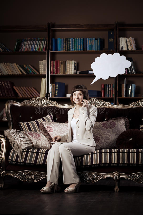 Woman with blank of thought and talking bubble. Business woman with blank of thought and speech / talking bubble royalty free stock images