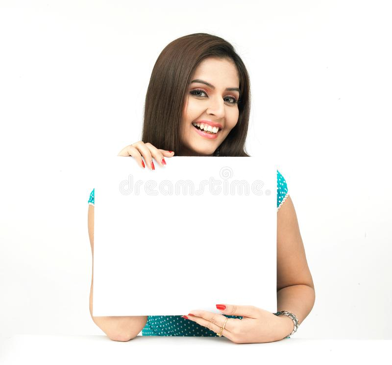 Woman with a blank white placard royalty free stock photography