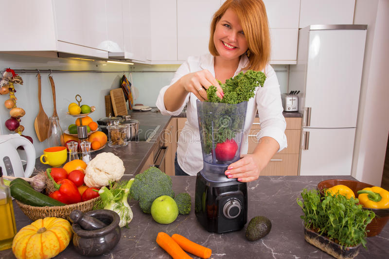 Woman blending vegetables royalty free stock images