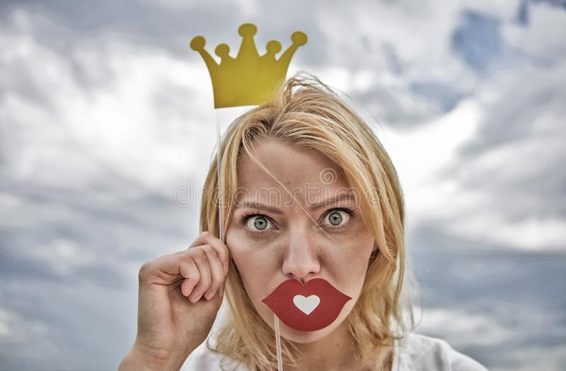 Woman blonde hair hold cardboard tiara or crown and red lips symbol of love sky background. Lady princess posing royalty free stock images