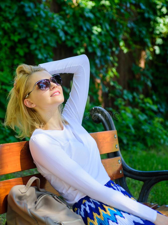 Woman blonde with sunglasses dream about vacation, take break relaxing in park. Dream vacation. Lady needs relax and stock image