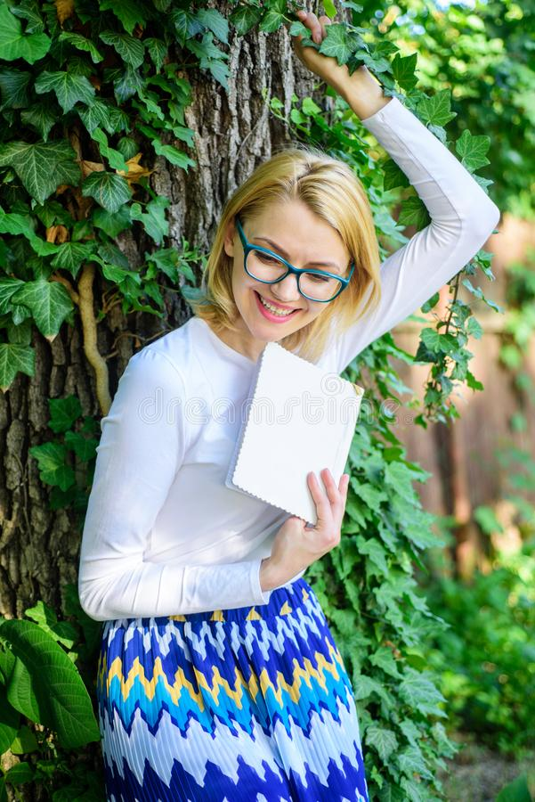 Woman blonde take break relaxing in park reading book. Lady cheerful laugh she likes funny stories. Bookworm student royalty free stock photo