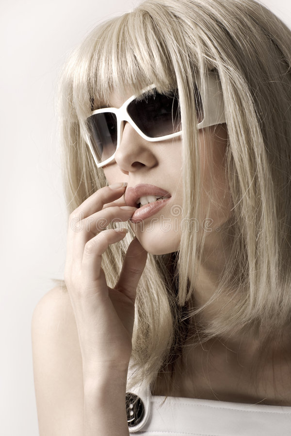 Woman in blonde wig and sunglasses stock photo
