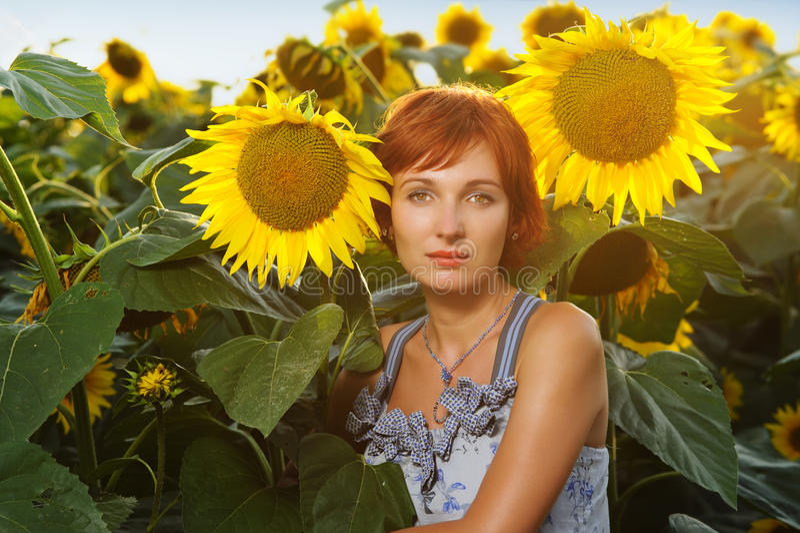 Woman on blooming sunflower field