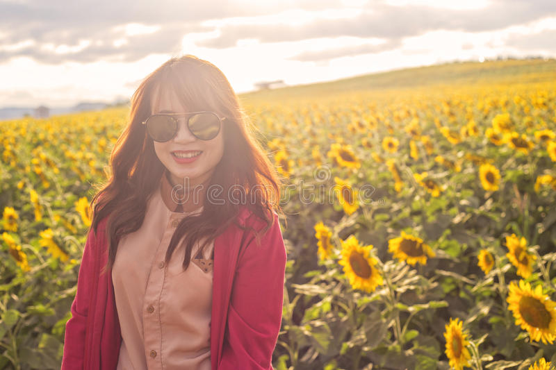 Woman on blooming sunflower field stock photography