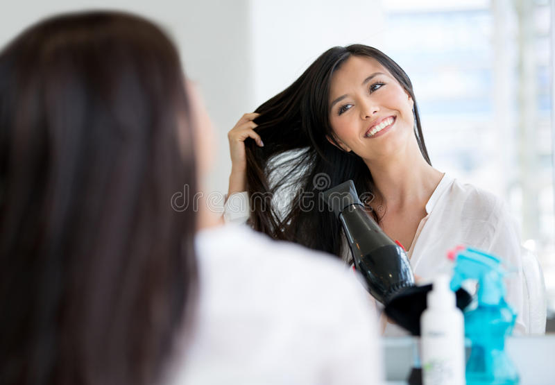 Download Woman blow drying her hair stock photo. Image of brunette - 30601156