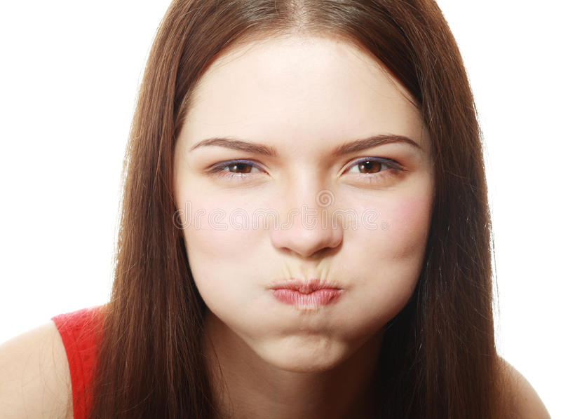 Woman blowing cheeks. Portrait of disgusted young woman blowing cheeks.White Background royalty free stock photo