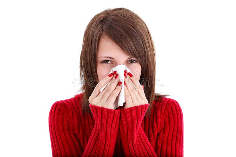 Woman blowing her nose stock photos