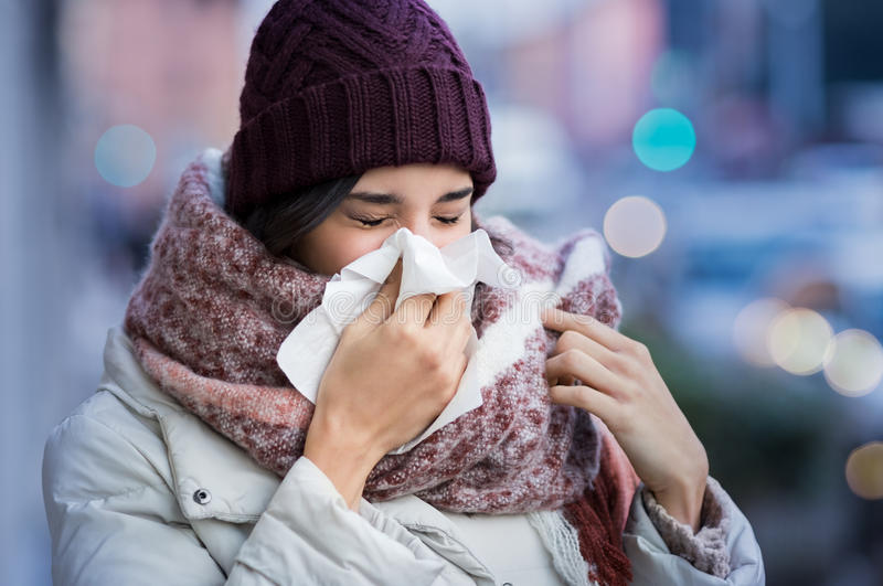 Woman blowing nose outdoor stock photos