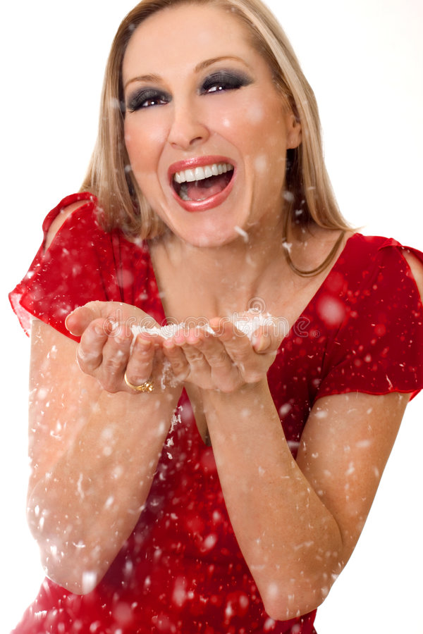 Woman blowing soft flakes stock photography